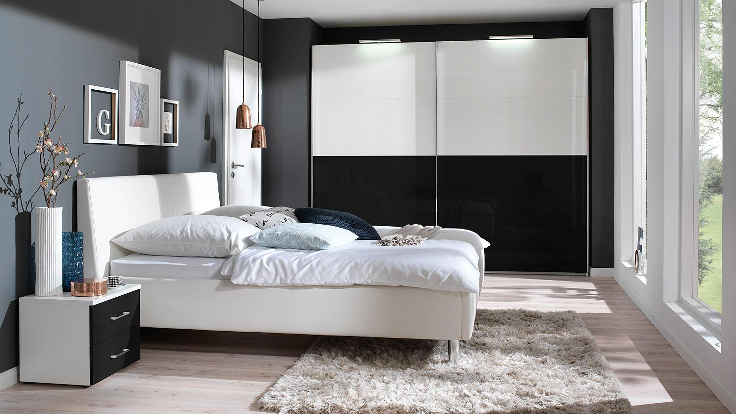 schlafzimmer kleiderschrankwunder in wei schwarz hochglanz wellem bel. Black Bedroom Furniture Sets. Home Design Ideas