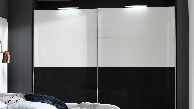 schlafzimmer kleiderschrankwunder in wei schwarz hochglanz wellem bel. Black Bedroom Furniture Sets. Home Design Ideas