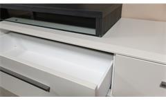 Wohnwand weiß matt lackiert Esche grau verschiebbare TV-Bank Studio 2 Anbauwand 1